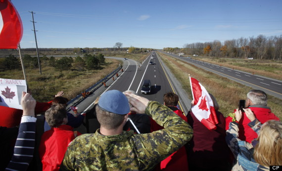 A Canadian Soldier salutes the hearse carrying the body of Cpl. Nathan Cirillo on the Veterans Memorial Highway in Ottawa on Friday, October 24, 2014. THE CANADIAN PRESS/ Patrick Doyle