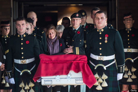 OTTAWA, ON - OCTOBER 24: Kathy Cirillo (center left), the mother of Cpl. Nathan Cirillo, follows the casket carrying her son, two days after he was shot dead by a gunman while he guarded the National War Memorial, during a precession from Ottawa to Cirillo's hometown of Hamilton, Ontario, on October 24, 2014 in Ottawa, Canada. After killing Cirillo the gunman stormed the main parliament building, terrorizing the public and politicians, before he was shot dead. (Photo by Andrew Burton/Getty Images)